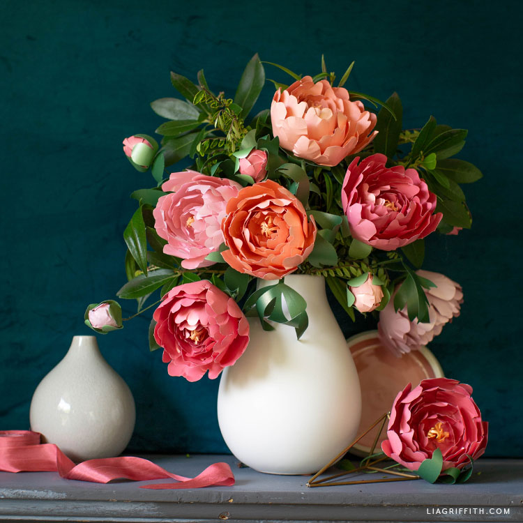 frosted paper peonies with real greenery in vase