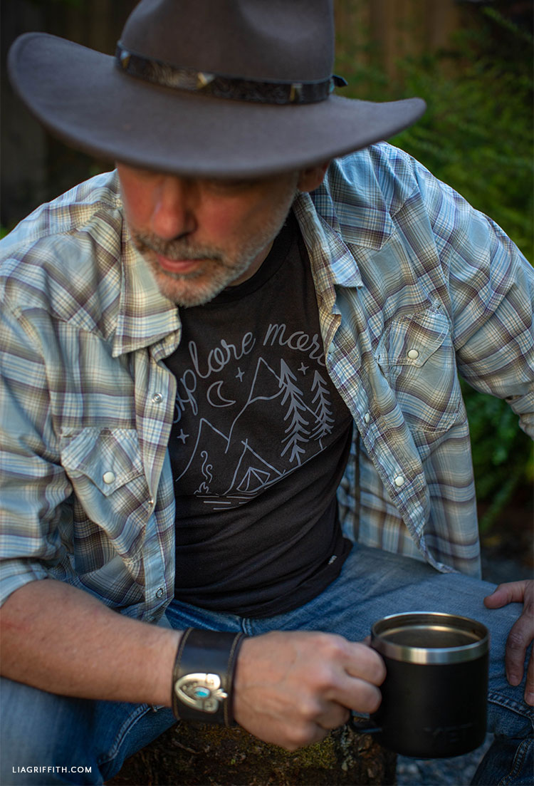Man wearing hat and explore more t-shirt