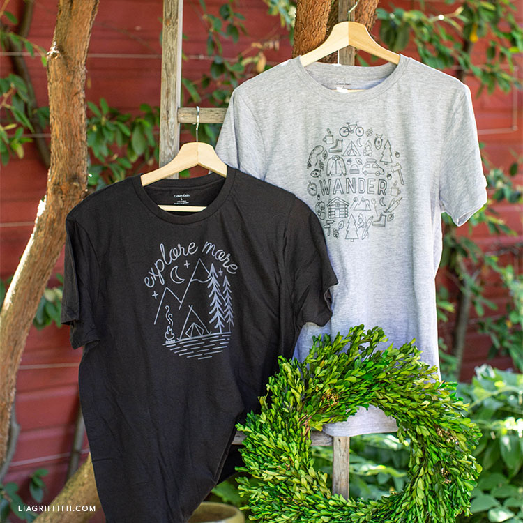 camping graphic tees with iron-on designs hanging on ladder outside