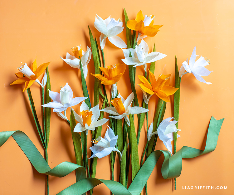 DIY crepe paper daffodil flowers in mango, chiffon, and white