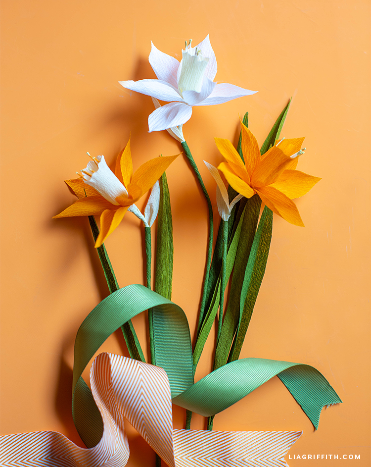 crepe paper daffodils in mango and white with leaves
