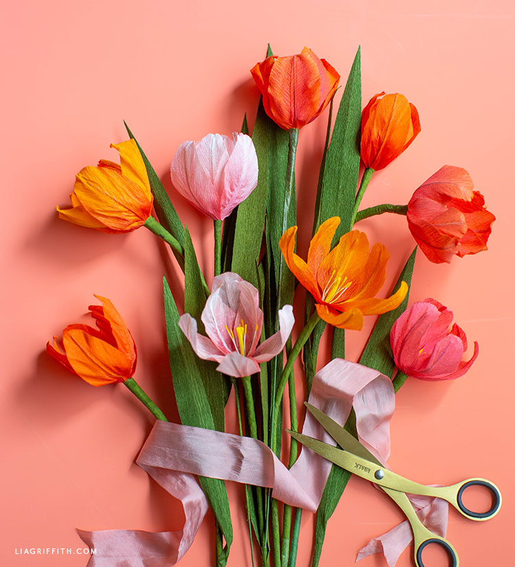 ombré crepe paper tulips with pink ribbon and scissors