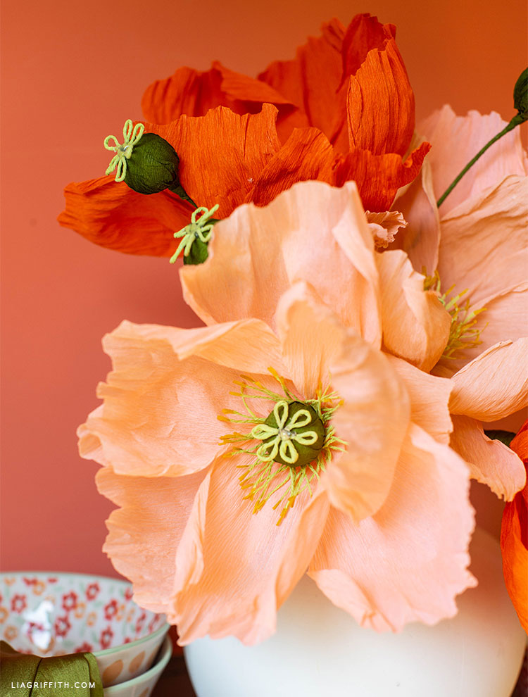close-up of crepe paper poppies and flower centers