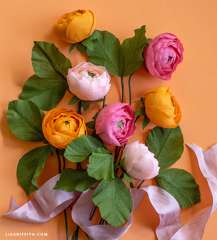 crepe paper ranunculus flowers in blush, pink, and orange