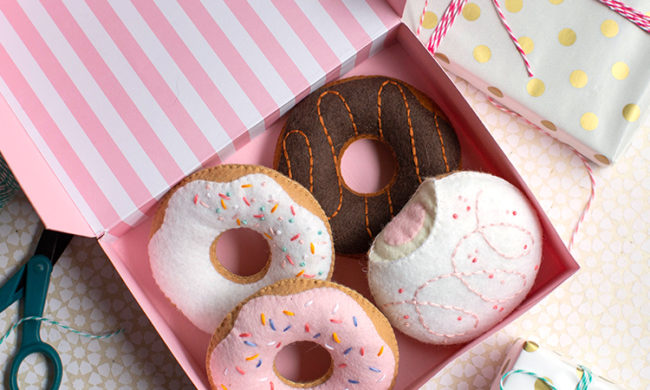 felt donuts in donut box next to gifts