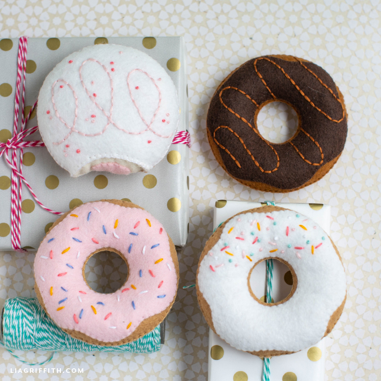 four hand-stitched felt donuts