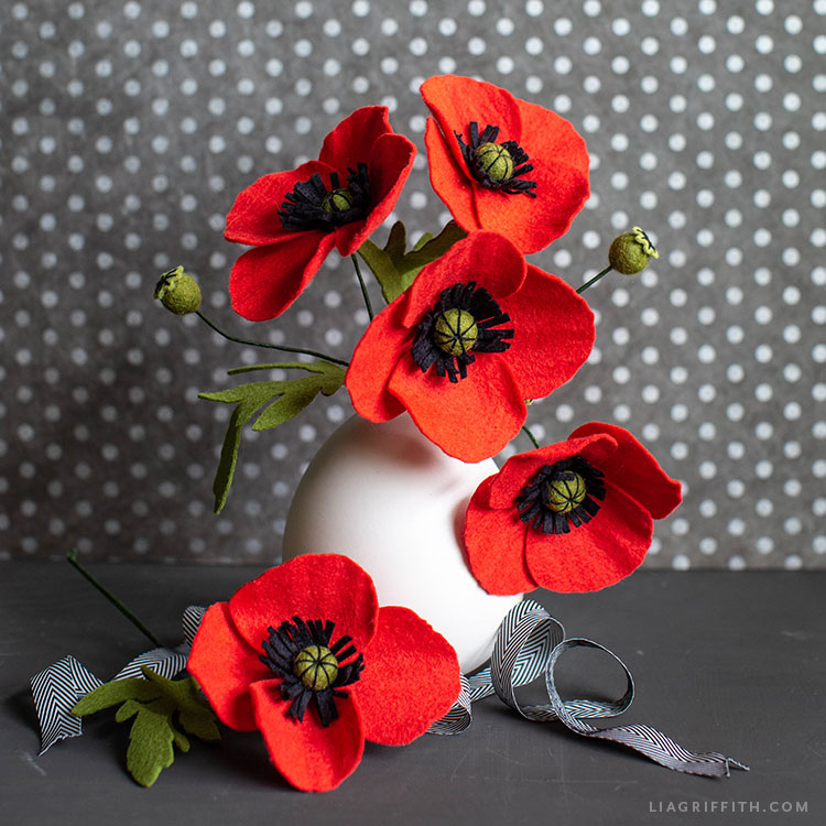 felt red poppies in white vase