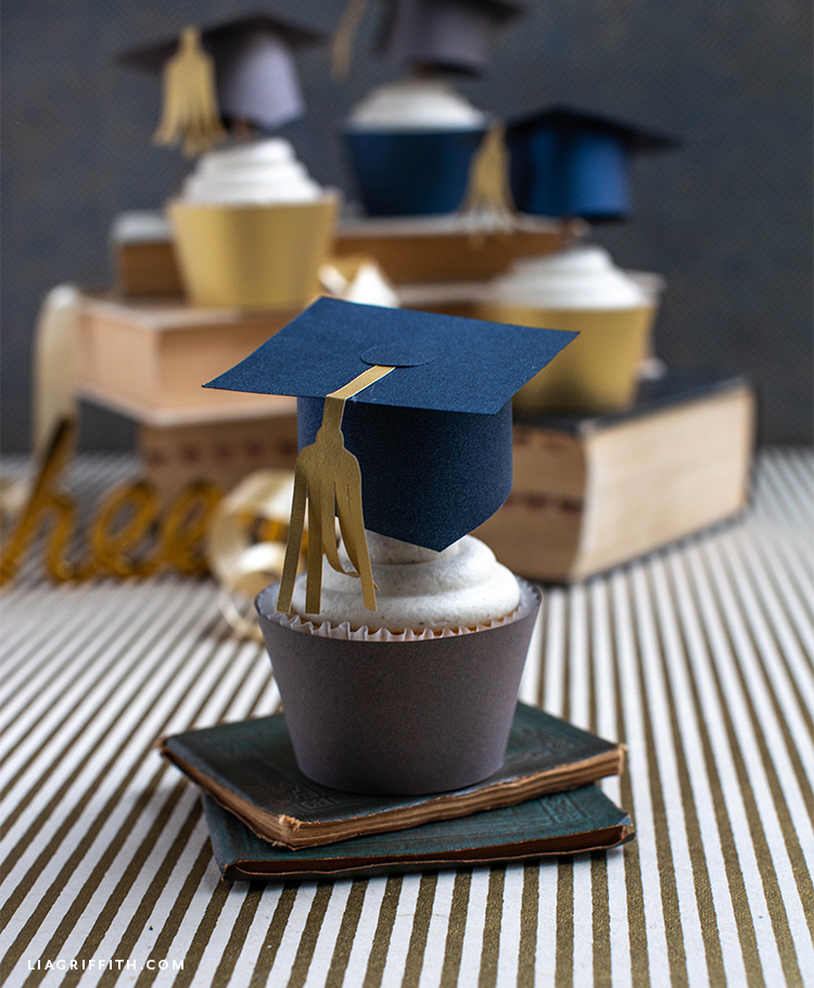 graduation cupcake toppers with cupcakes on books