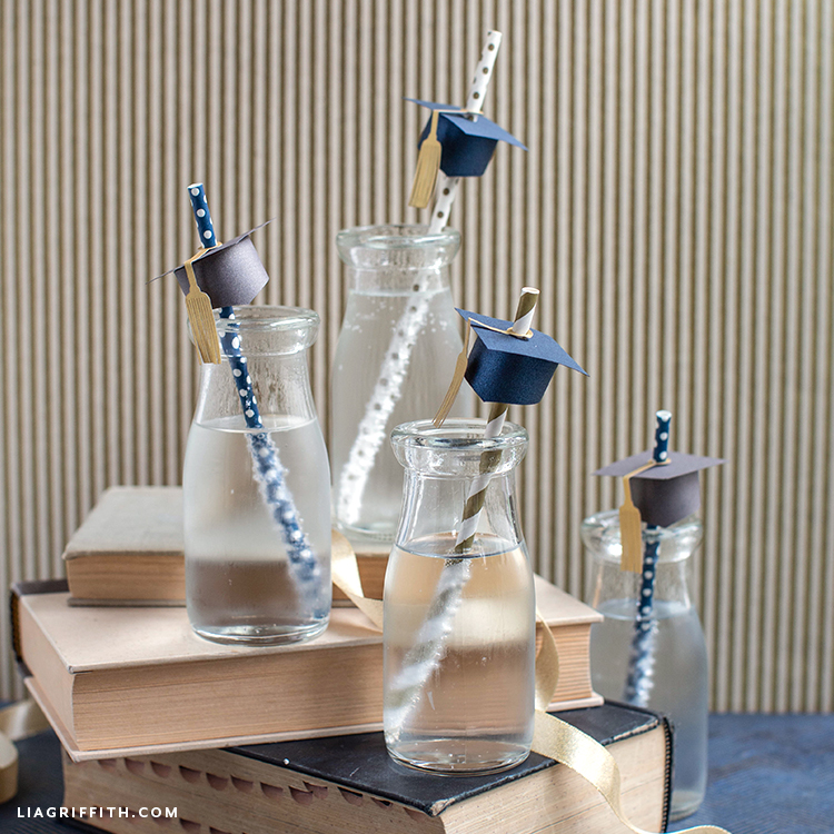 graduation party straw toppers in drinks on books