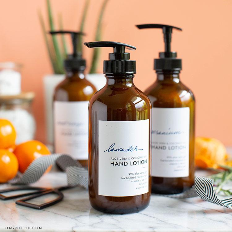 three hand lotion recipes next to oranges, scissors, and ribbon