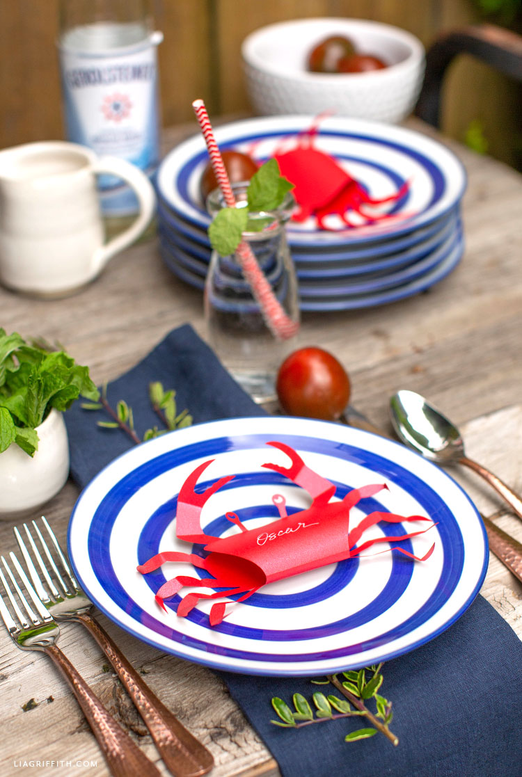 paper crab place card with nautical dishes