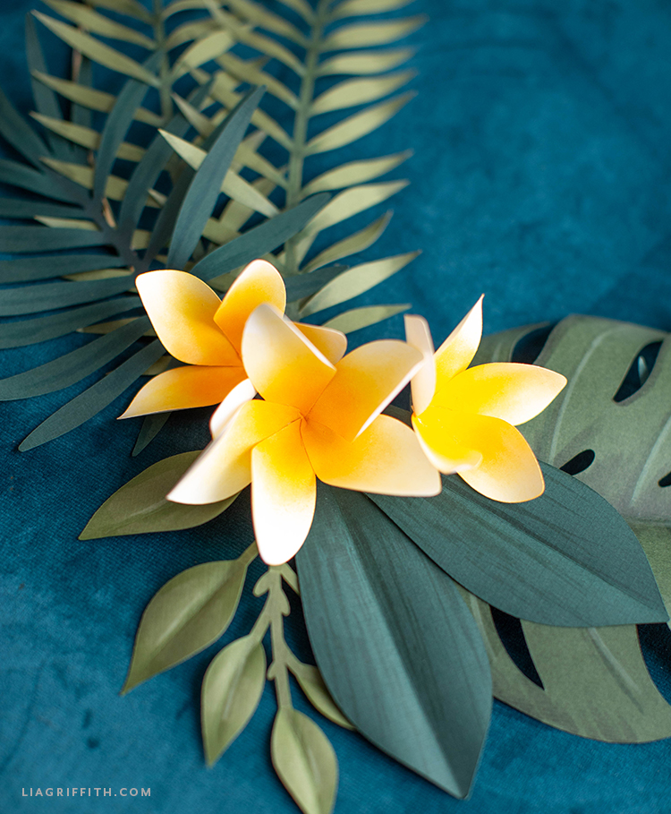 papercut plumerias and tropical leaves