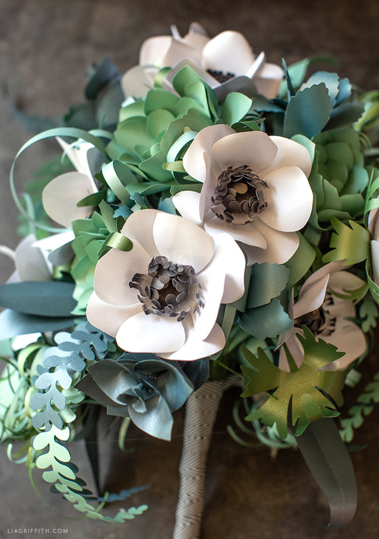 paper succulent bridal bouquet with paper anemone flowers, air plants, and ferns