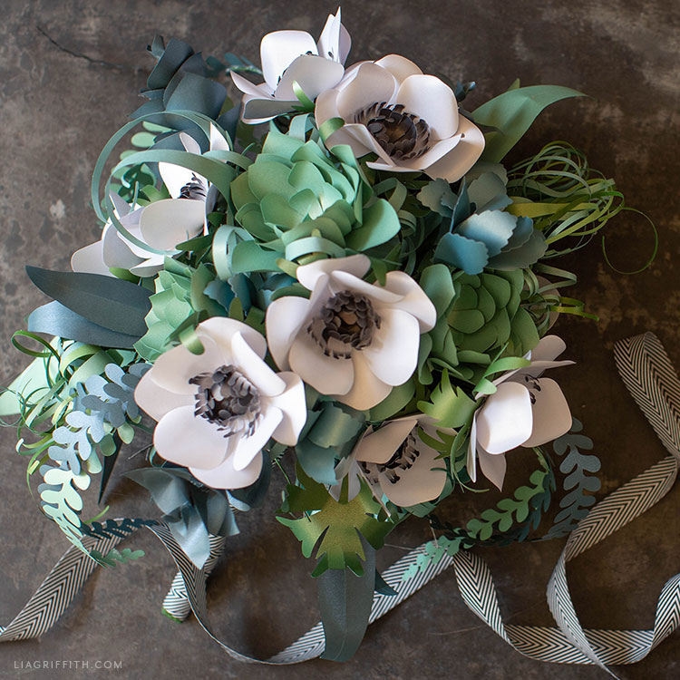 DIY wedding bouquet with paper anemones, succulents, air plants, and ferns