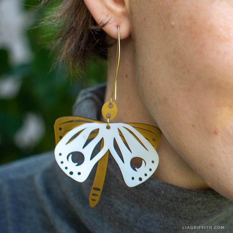 handmade shrink film moth earrings