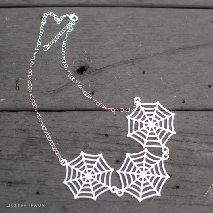 DIY shrink film spider web necklace