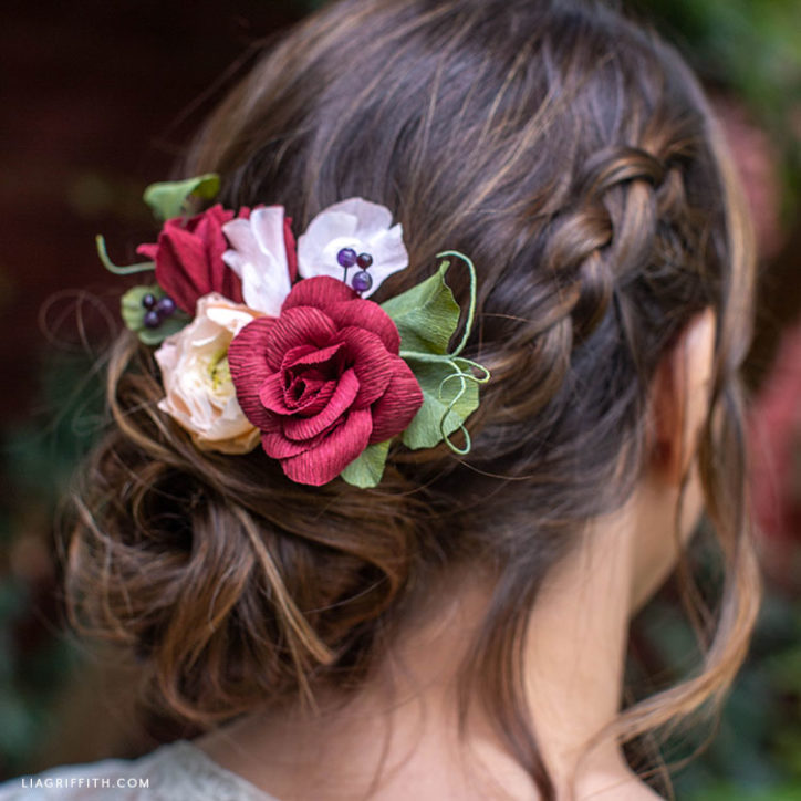 crepe paper flower hair comb with roses, sweet peas, ranunculus, and greenery