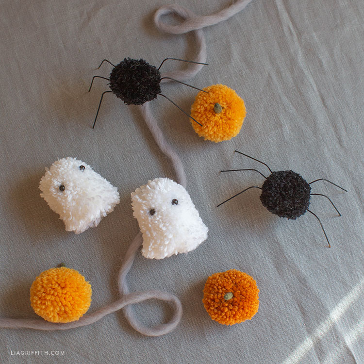 pom-pom ghosts, spiders, and pumpkins