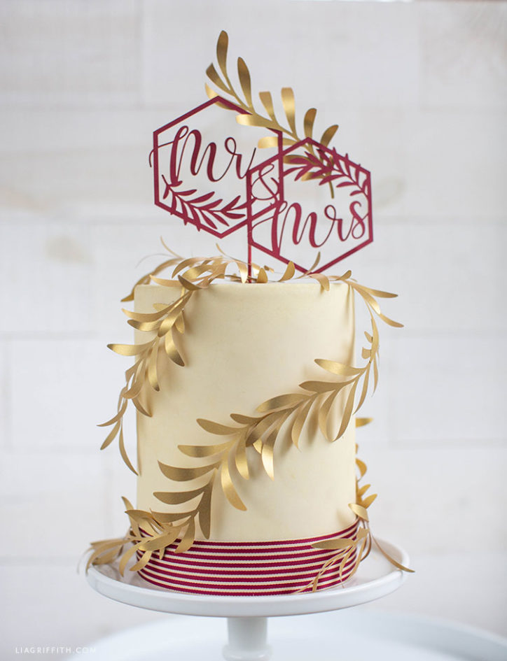 papercut Mr and Mrs wedding cake topper and olive branches
