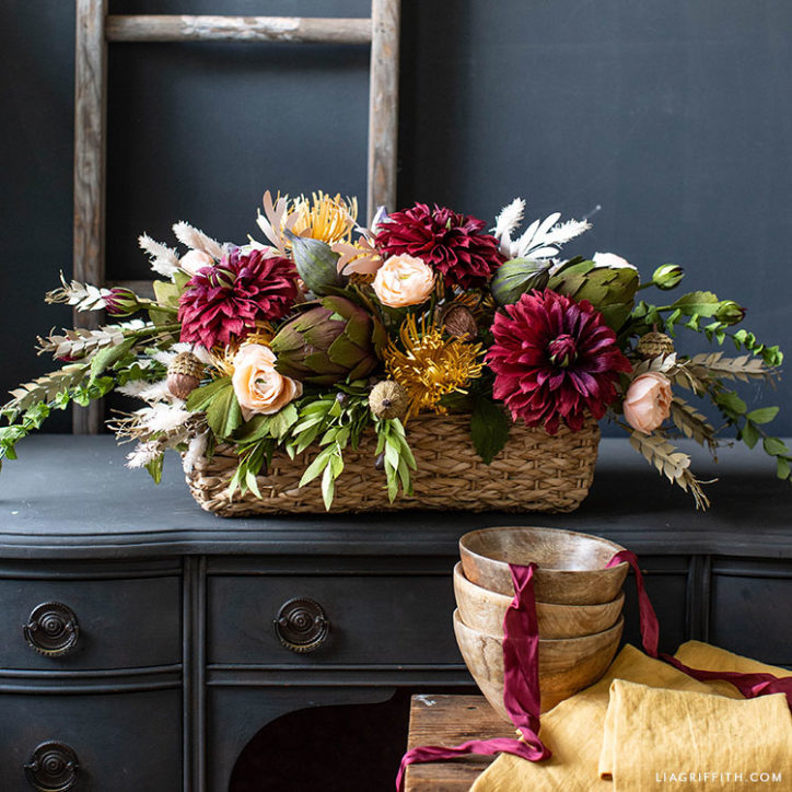 Thanksgiving centerpiece with crepe paper flowers and fruit
