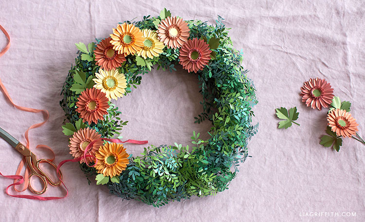 papercut boxwood wreath with frosted paper daisies