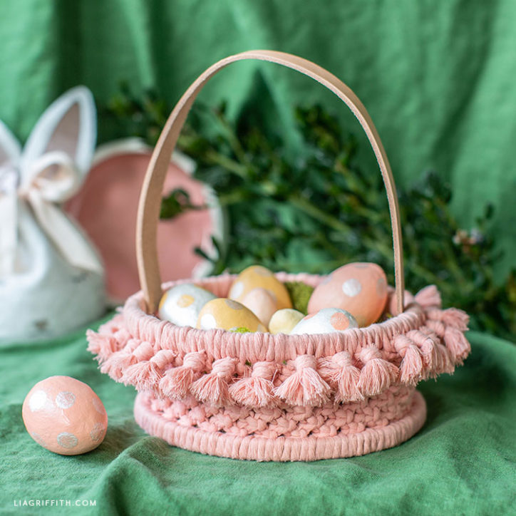 pink macrame Easter basket with painted eggs