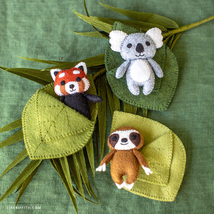 felt red panda, koala, and sloth in felt leaves