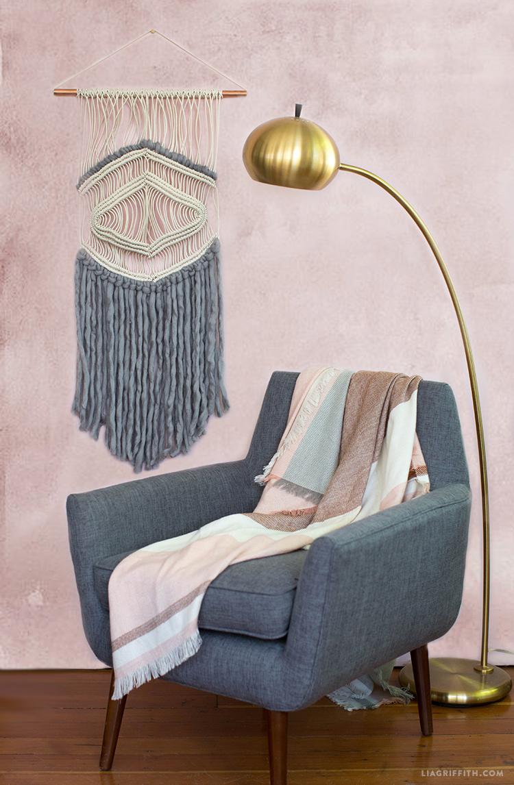 Photowall pink wallpaper with macrame yarn wall hanging