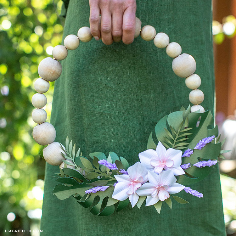 wooden bead wreath with paper flowers