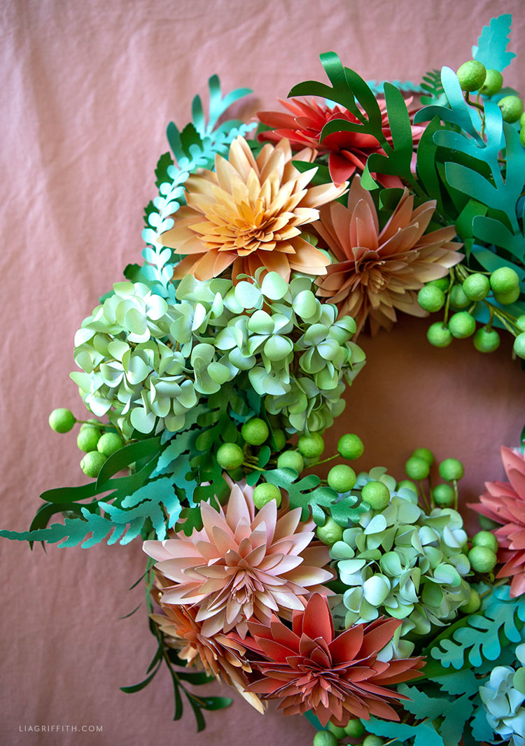 frosted paper dahlias, hydrangeas, ferns, eucalyptus, and paper berries