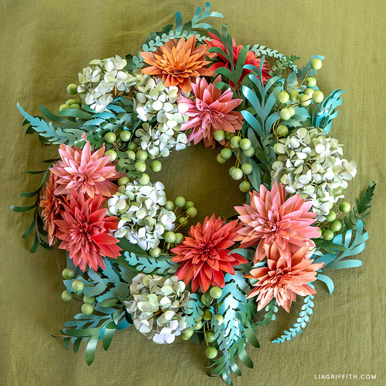 handmade wreath with frosted paper dahlias, hydrangeas, greenery, and paper berries