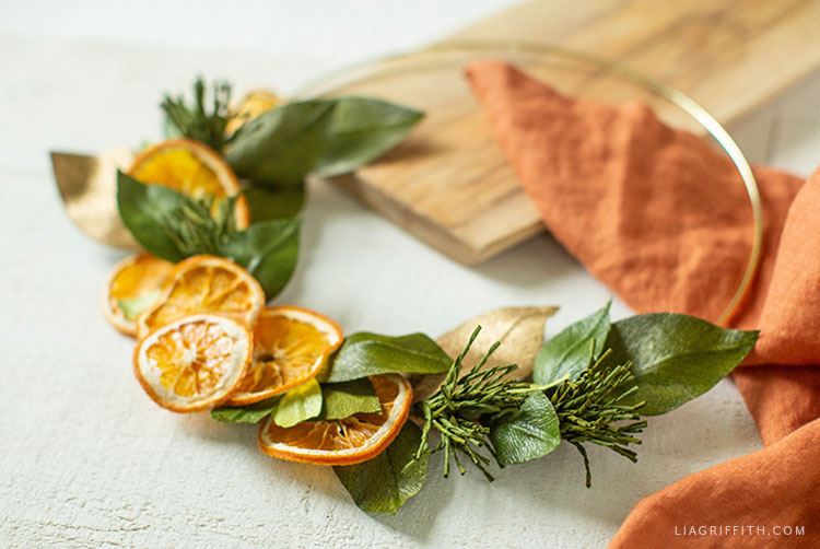 dried orange and crepe paper leaf wreath
