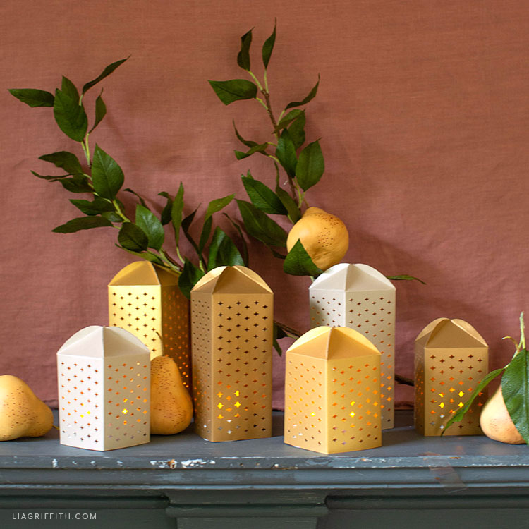 papercut luminaries and crepe paper pear branch mantel decor