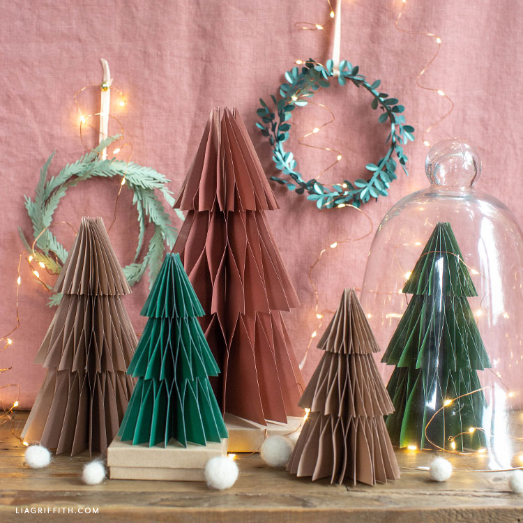 frosted paper honeycomb trees and paper wreaths for Christmas decor