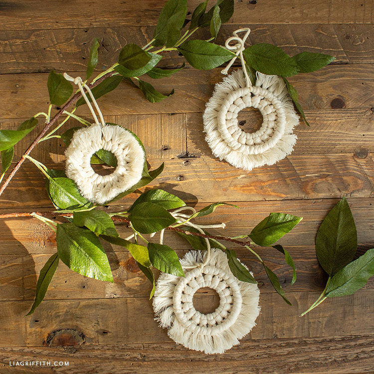 macrame wreath ornaments with crepe paper leaf branch