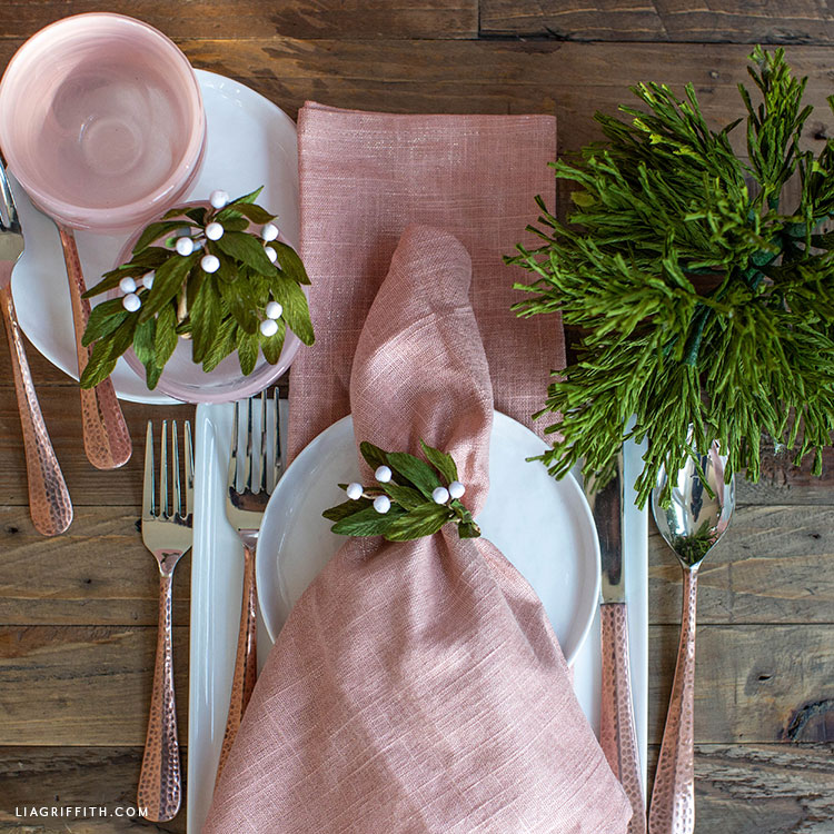 DIY crepe paper mistletoe napkin rings for holiday table