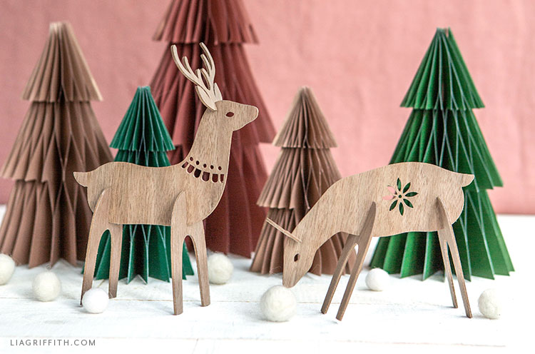 DIY wood deer decorations and frosted paper honeycomb trees