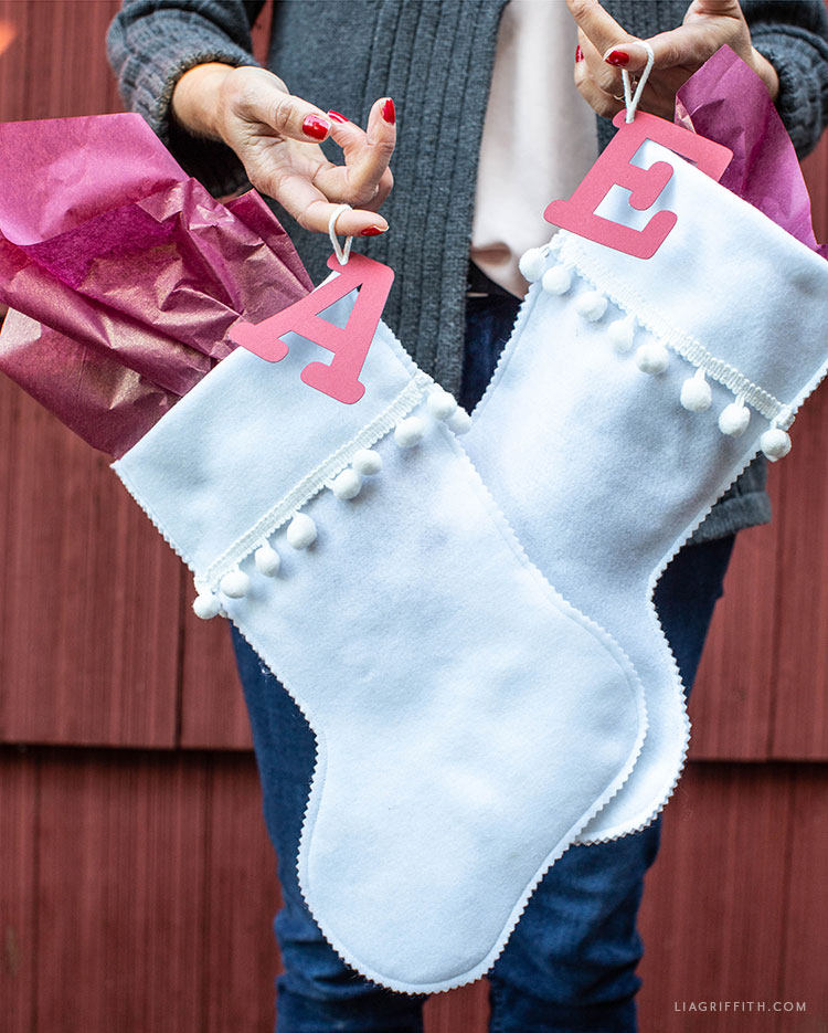 felt stocking gift bags with papercut initial
