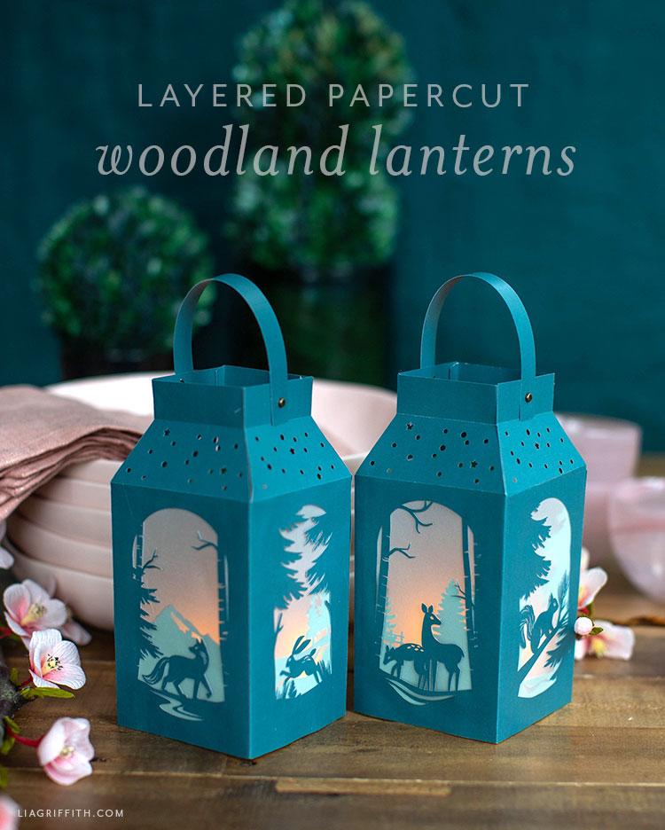 layered papercut woodland lanterns