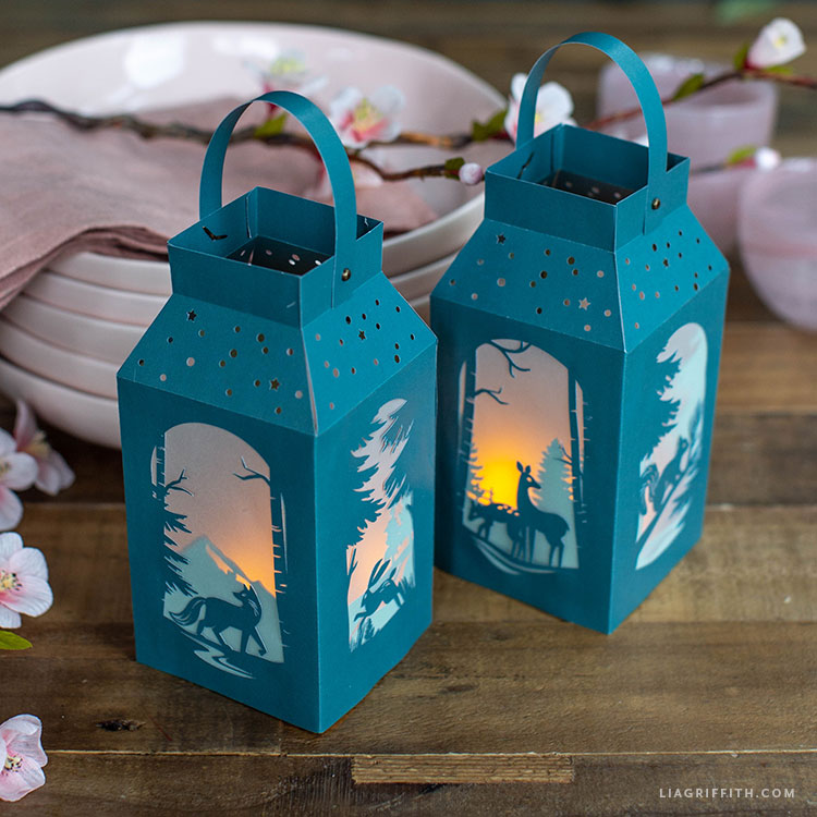 handmade paper lanterns with woodland scenes