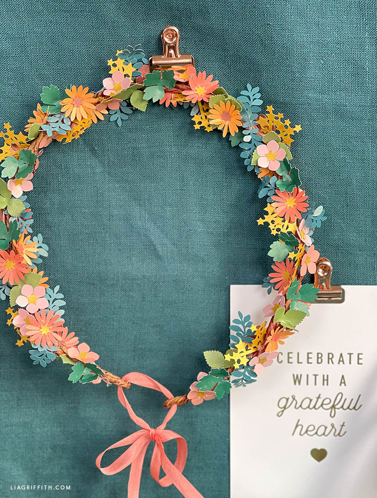 DIY wreath with paper flowers, stars, and leaves