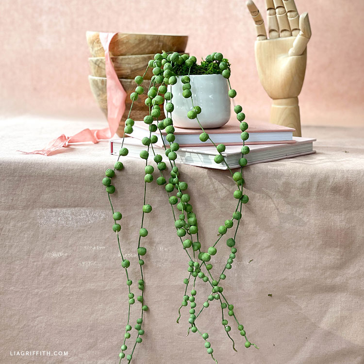 string of pearls made from cotton spun paper balls