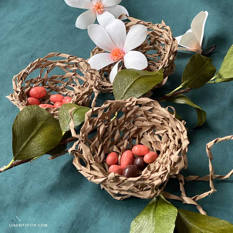 recycled paper bag bird nest with crepe paper flowers
