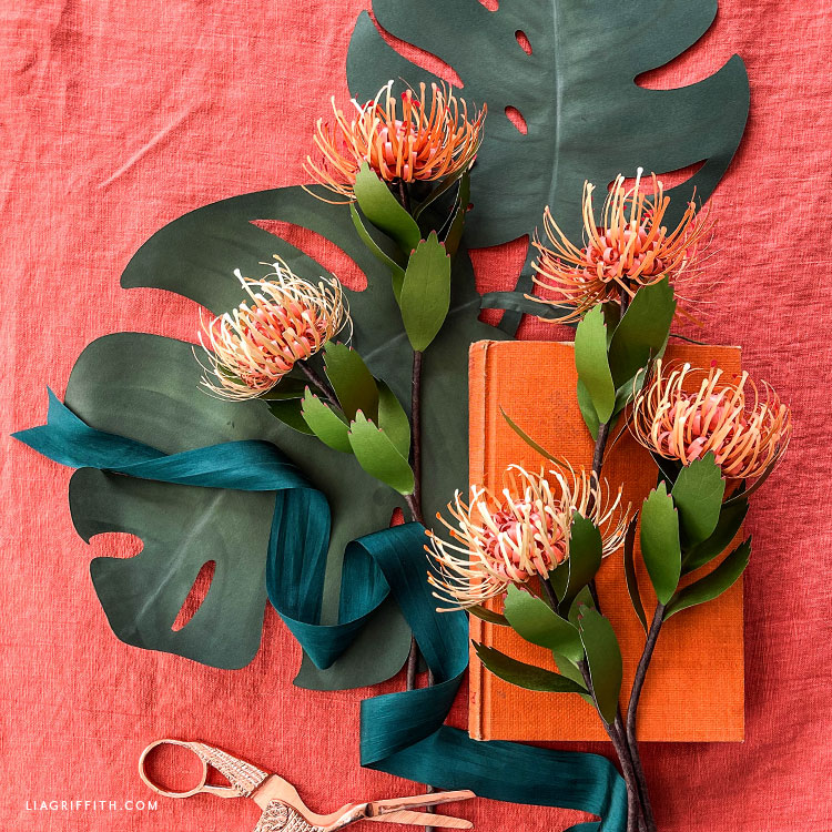 frosted paper pincushion protea and paper monstera leaves