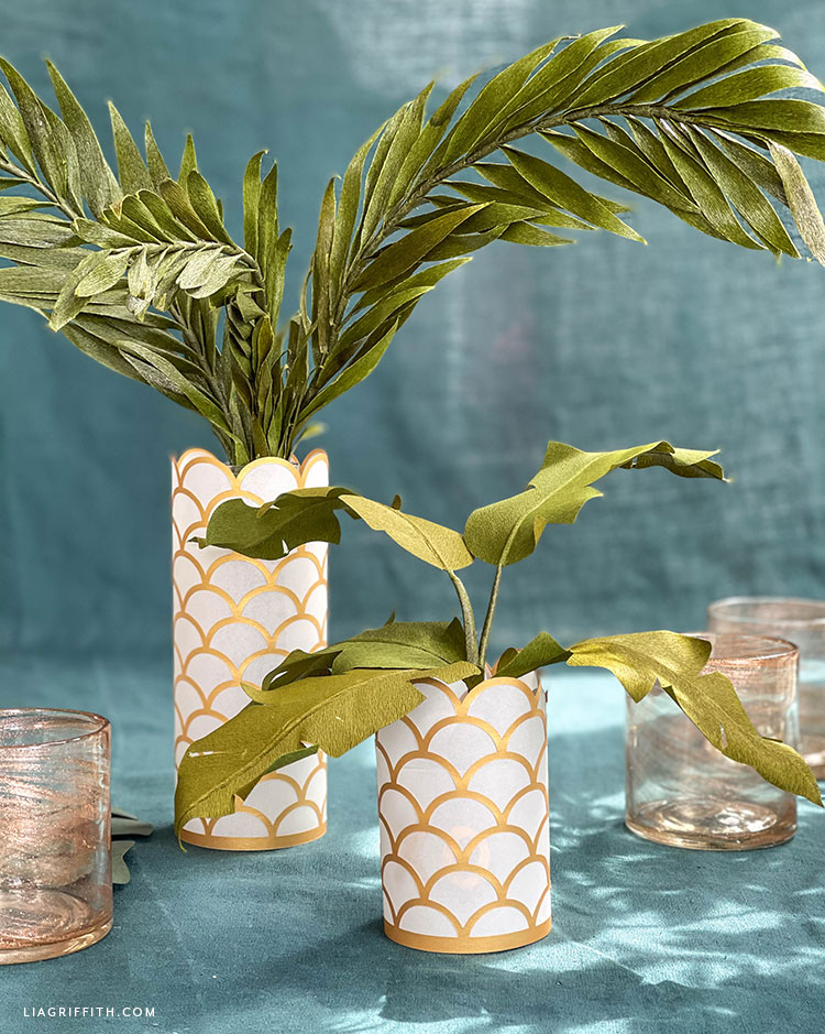 papercut scalloped lanterns with paper tropical leaves