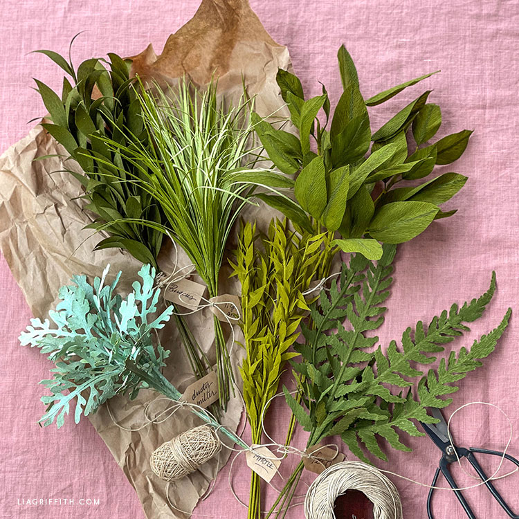 crepe paper ferns, salal leaves, lily grass, dusty miller, ruscus, and lily grass