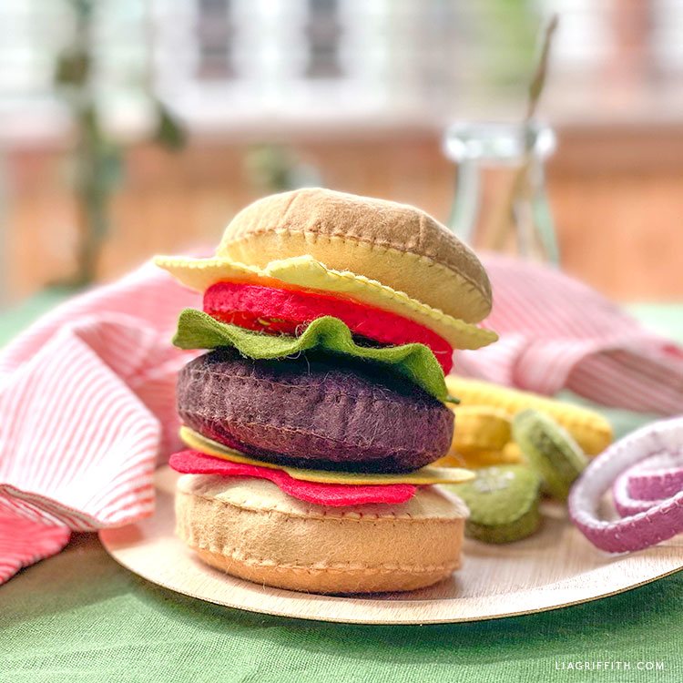 felt burger with felt cheese, tomatoes, lettuce, and condiments