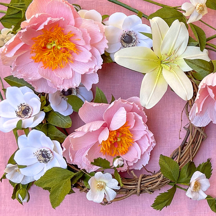 A bright pastel collection of paper flowers.