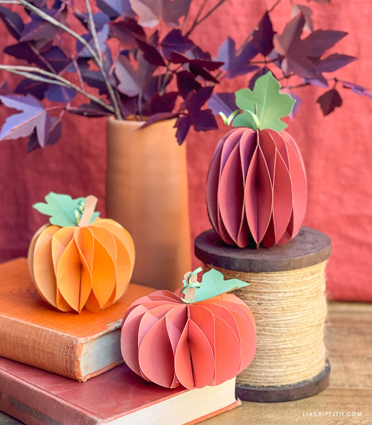 frosted paper honeycomb pumpkins and fall leaf branch decor